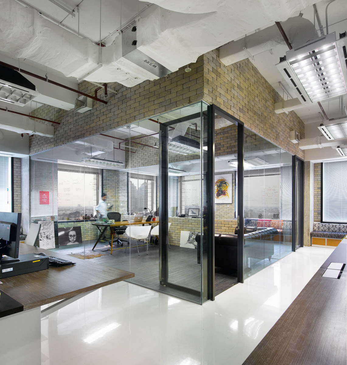 Tour the creative and collaborative office of bates 141 for Industrial office interior